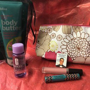 Lg Floral Clinique Bag with mixed beauty products